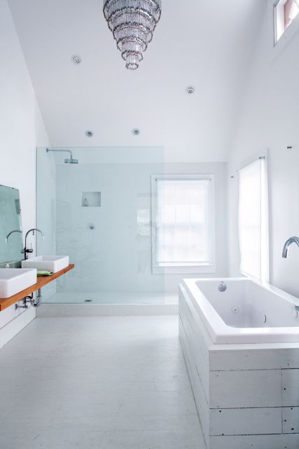 add a beach feel to the bathroom with a bathtub clad with whitewashed salvaged wood