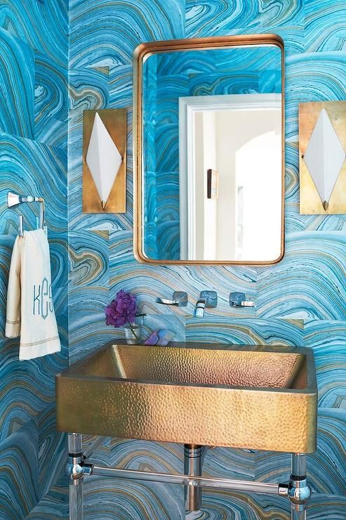 blue agate printed wallpaper with brass accessories and a sink for a refined feel