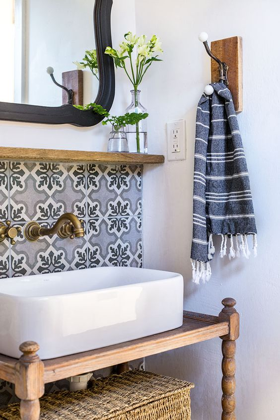 blue printed mosaic tiles and a vintage brass faucet for creating a chic look