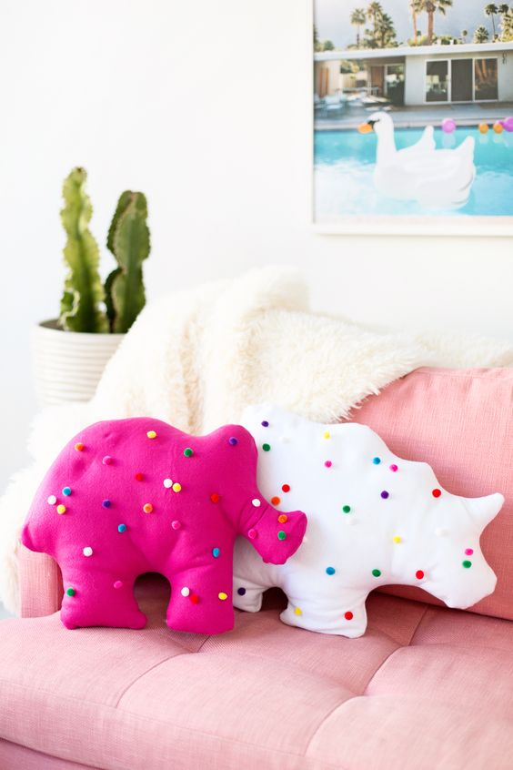 circus animal cookie pillows with colorful pompoms can be DIYed by you