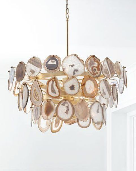 a gorgeous geode chandelier with brass touches will make a trendy statement