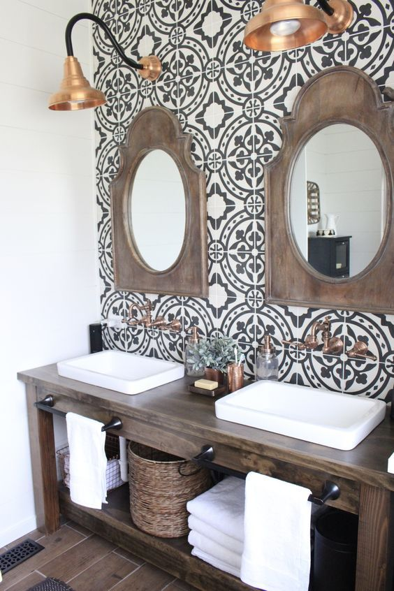 black and white patterned tiles on the sink wall are used for a cool accent