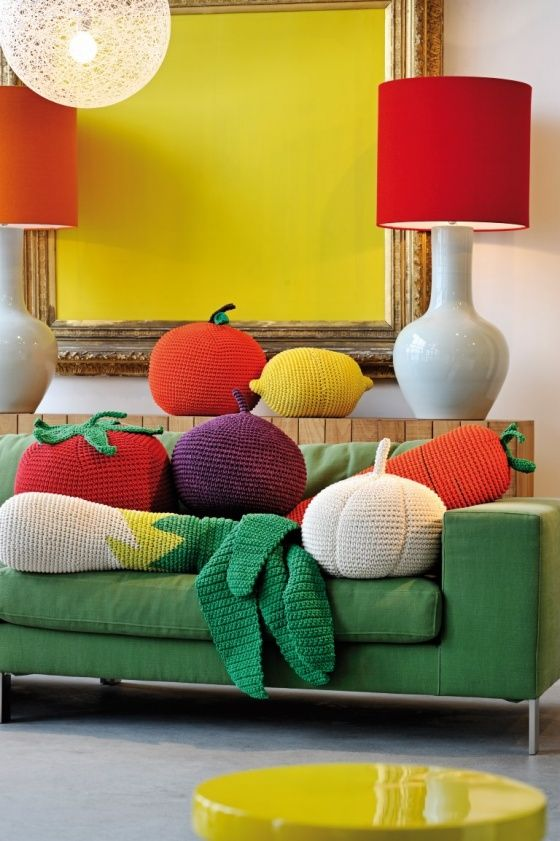 colorful crocheted vegetable and fruit pillows to make the space lively and bold