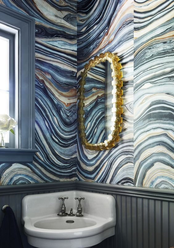 spruce up your bathroom with agate print wallpaper and a gold framed mirror