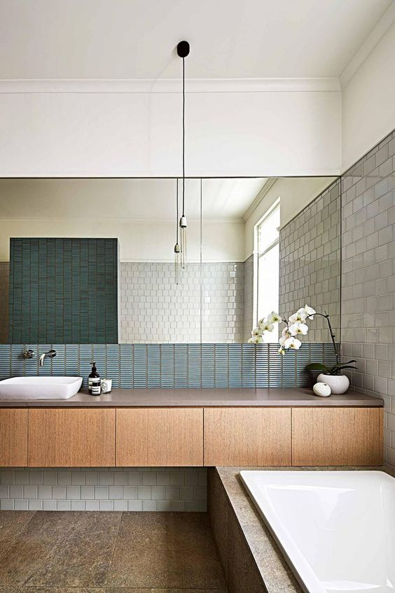 very small blue tiles for the bathroom backsplash add a texture and an interesting touch