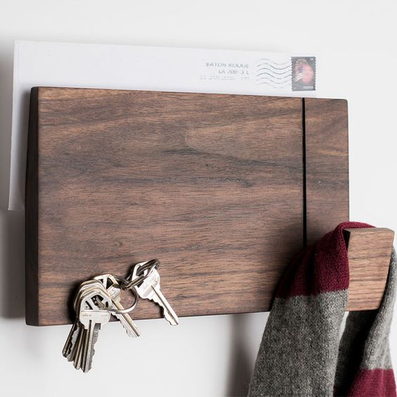 a multi-purpose wood wall rack can hold mail, scarves or bags and some keys, too
