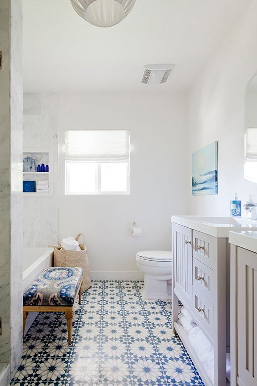 blue patterned tiles on the floor and some blue accents for a bold and bright look