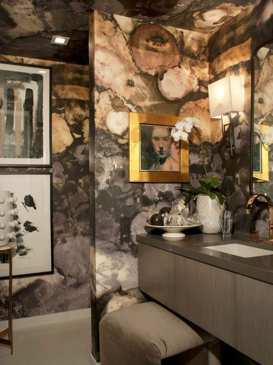 the moody geode wallcovering elicits a jewel-box feel in this refined bathroom