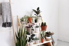 13 a modern and comfy ladder plant stand for a modern and fresh serene space