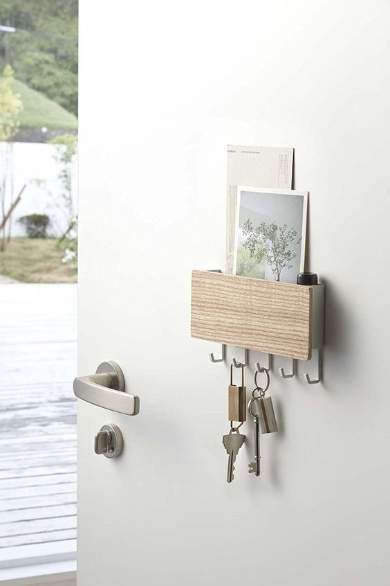 a small and functional unit allows holding cards, mail and some keys, too