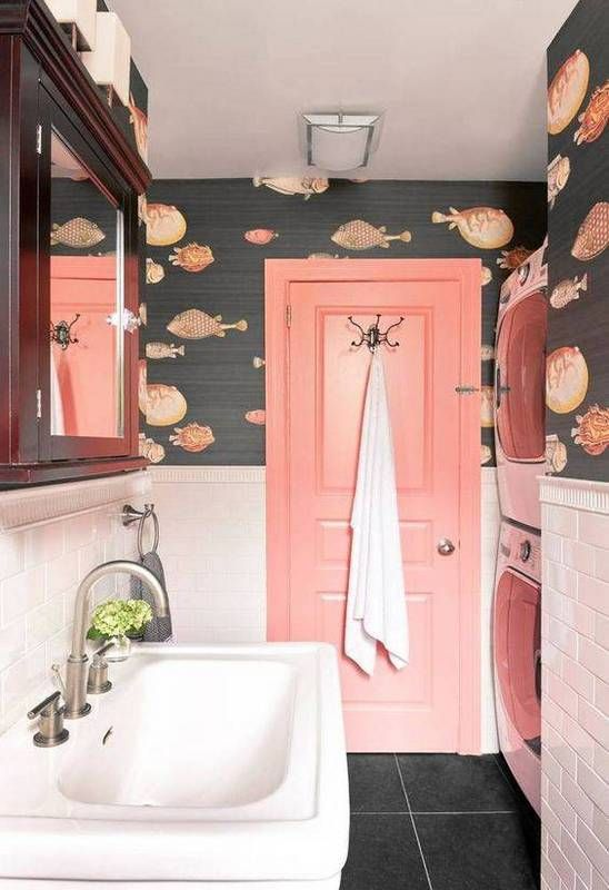 blush tiles and whimsy fish print wallpaper create a fun space, which is suitable for kids