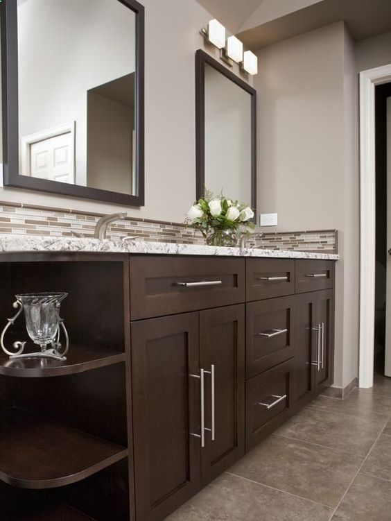 a narrow tile backsplash that matches the vanity countertop and adds a print to the look