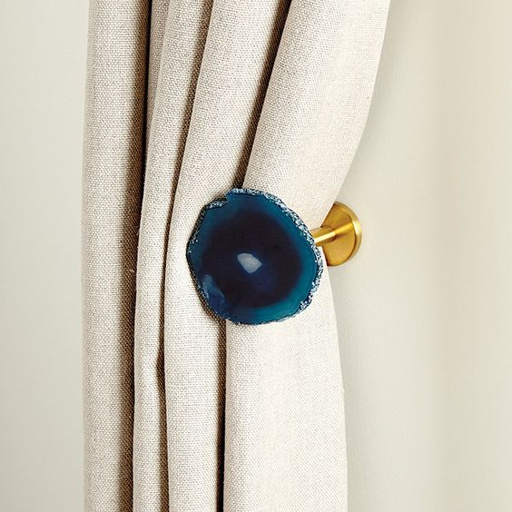 an agate drapery tieback is a trendy way to keep your curtains in order