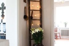 15 a ladder with hanging candle holders in the corner is a great idea to decorate an awkward space