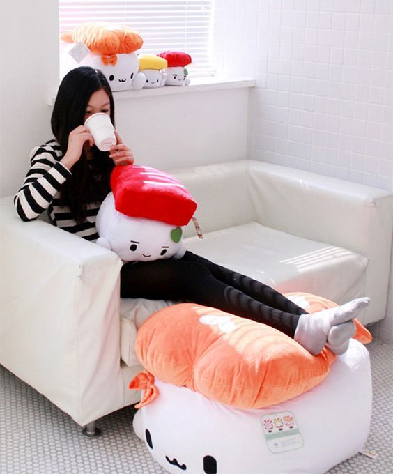 a large kawaii sushi pillow is a floor piece to use as a footrest or an ottoman