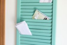 15 an old shutter painted and transformed into a key rack with enough mail storage