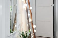 16 a ladder with lights will fill your entryway with light and style