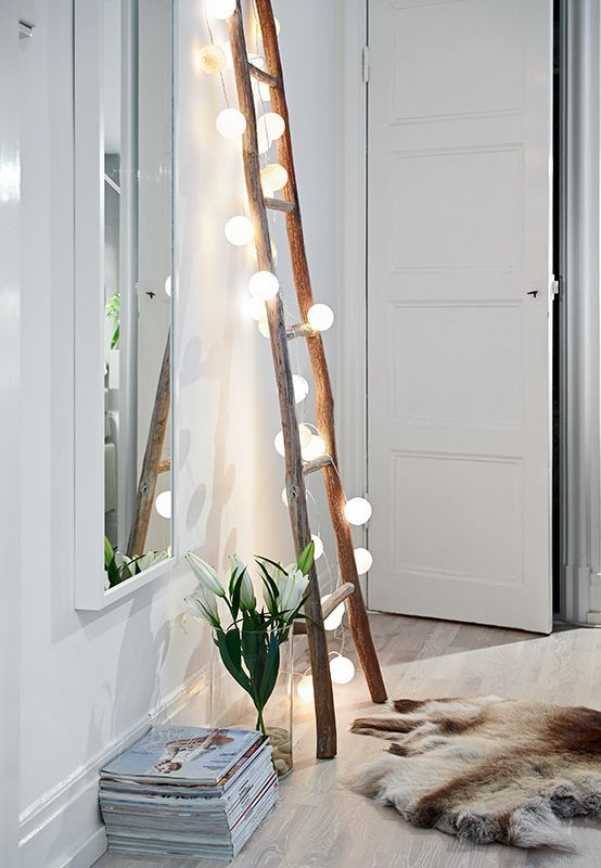 a ladder with lights will fill your entryway with light and style