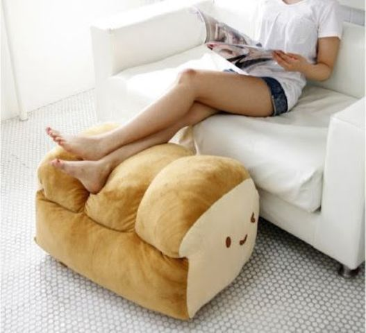 a large loaf pillow can be used as an ottoman or a usual pillow