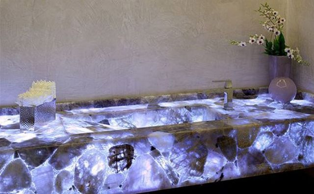 an agate-inspired sink with a vanity incorporated lit from the inside for a spectacular look