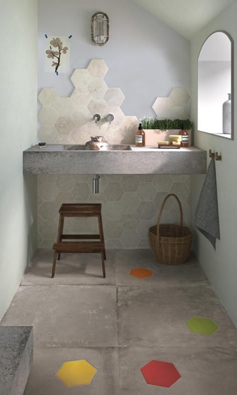 marble hexagon tiles that match the concrete floor as a backsplash