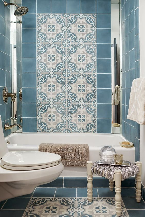 two eye-catchy accents of patterned Moroccan tiles on the wall and floor