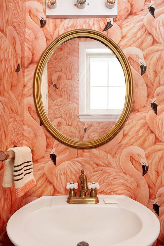 use coral flamingo wallpaper and brass touches to create a glam bathroom look