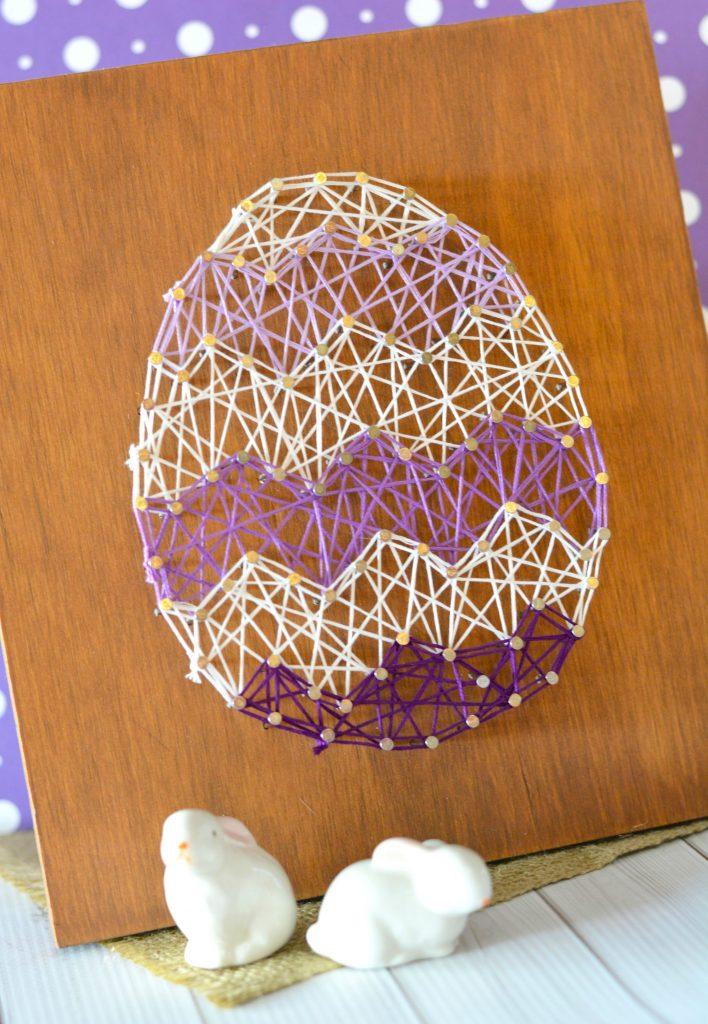 DIY purple and white Easter egg string art piece (via www.survivingateacherssalary.com)