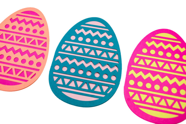 DIY colorful papercut Easter cards shaped as eggs (via tinselandtrim.com)