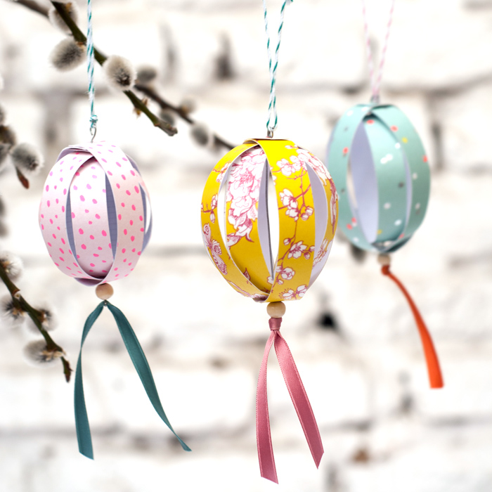 DIY paper egg ornaments with beads (via www.johannarundel.de)
