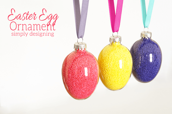 DIY glass egg ornaments filled with colorful sprinkles (via simplydesigning.porch.com)
