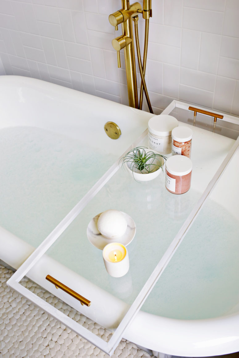DIY lucite bathtub caddy or tray (via abeautifulmess.com)