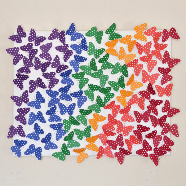 DIY rainbow polka dot butterfly wall art (via www.dreamalittlebigger.com)