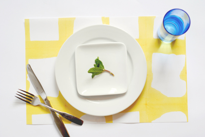 DIY bold yellow dipped placemats for Easter (via designformankind.com)