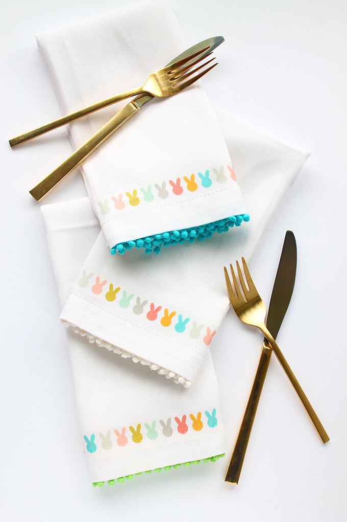 DIY colorful Easter bunny napkins with pompom trim (via squirrellyminds.com)