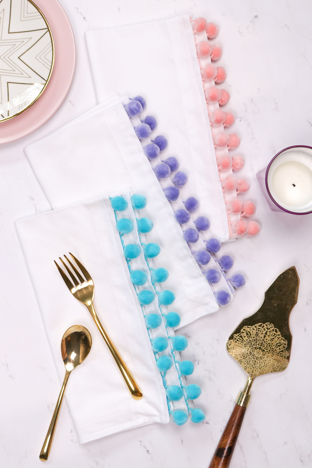 DIY colorful pompom trim napkins