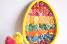 DIY Easter egg wall art with colorful buttons