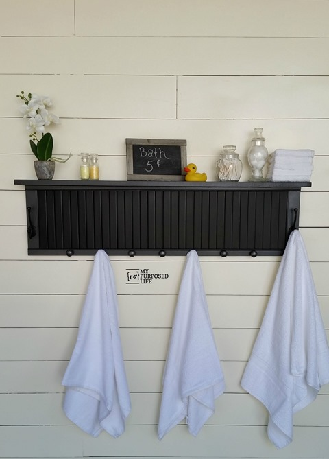 DIY painted shutter bathroom shelf with hooks (via www.myrepurposedlife.com)