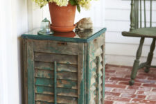 DIY vintage shutter side table with a glass top
