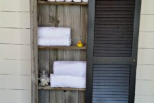 DIY rustic shutter bathroom cabinet