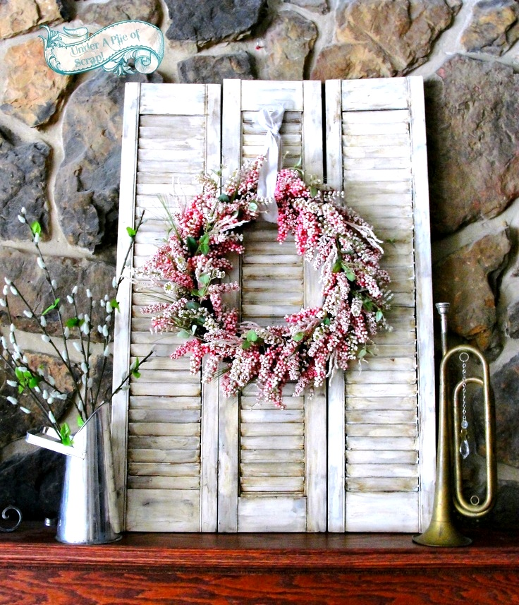 DIY old shutter decor with a wreath (via www.funkyjunkinteriors.net)