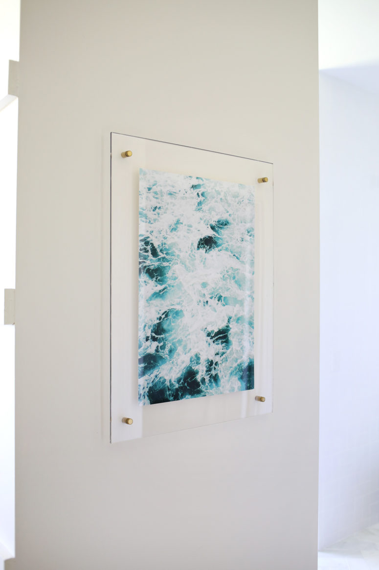 DIY floating acrylic frame with brass screws (via abeautifulmess.com)