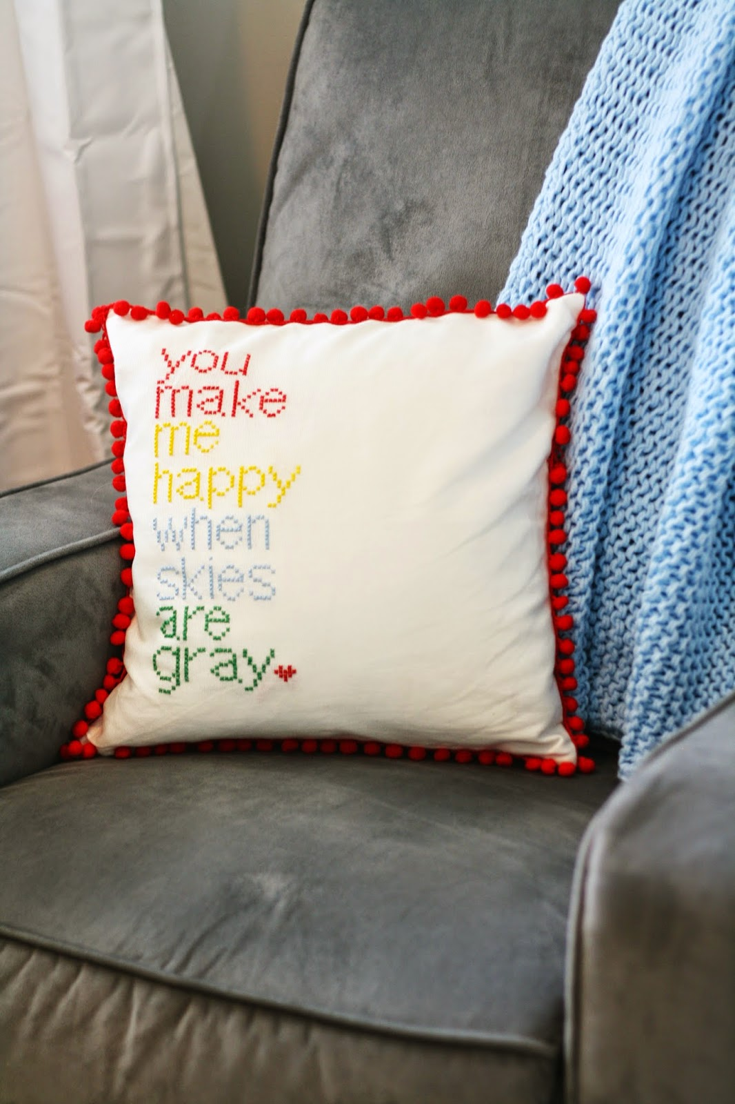 DIY cross stitched pillows with pompoms
