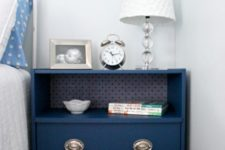 02 a blue Rast makeover with silver handles and an open shelf done with wallpaper