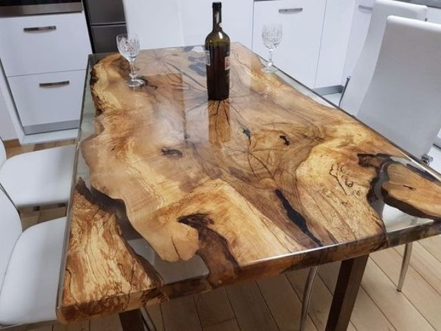 a fastastic cherry wood and resin dining table looks very natural and beautiful