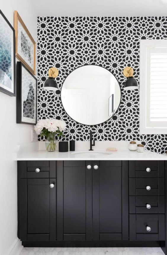 cool floral black and white wallpaper makes a stylish statement in the space and catches an eye