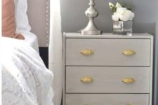 04 a light grey IKEA Rast hack with vintage gilded handles is a great nightstand for a vintage bedroom