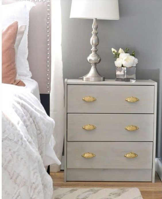 a light grey IKEA Rast hack with vintage gilded handles is a great nightstand for a vintage bedroom