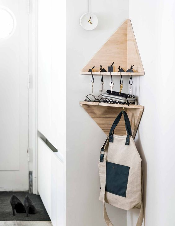 small triangle shelves for keys and for hanging bags and backpacks are ideal for entryway