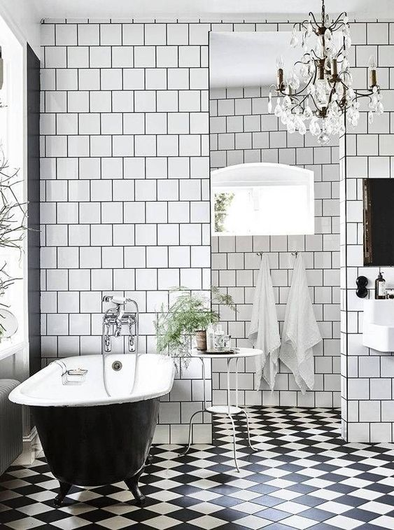 a checked black and white floor is ideal to add a vintage feel to the bathroom
